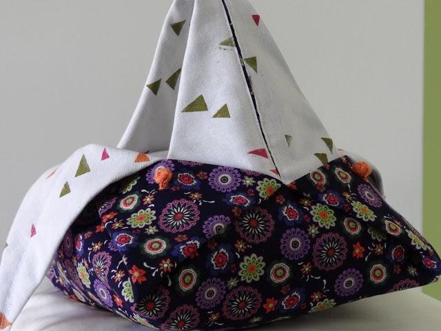 Bolso origami con botón